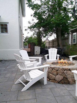 Chatham Cape Cod vacation rental - Gas fire pit, gas grill, and dining area