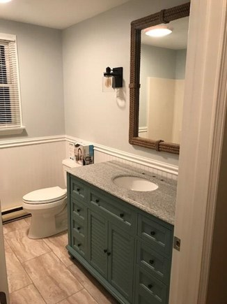 Eastham Cape Cod vacation rental - Downstairs updated full bathroom with tub/shower.