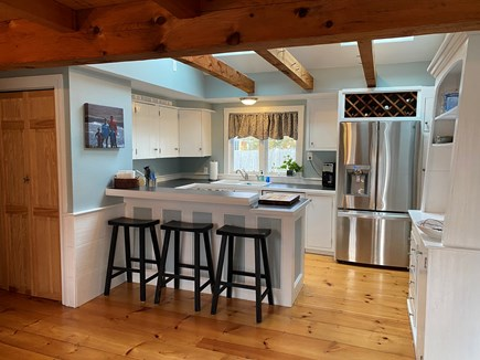 South Yarmouth Cape Cod vacation rental - Kitchen area with barstools. Stainless fridge with ice and water