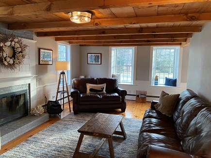 South Yarmouth Cape Cod vacation rental - Living room w/ leather couches & rough sawn wood ceiling