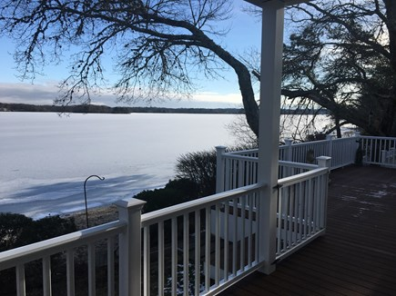 Centerville -Lake Wequaquet Cape Cod vacation rental - ENJOY! Sit and relax on wrap around deck steps to sandy beach.