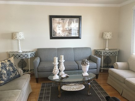 Centerville -Lake Wequaquet Cape Cod vacation rental - Living room with ample seating to open dining area beautiful view