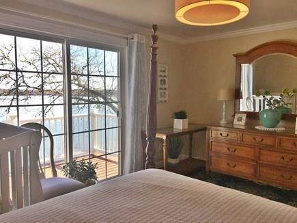 Centerville -Lake Wequaquet Cape Cod vacation rental - Upstairs bedroom with private deck overlooking stunning lake.