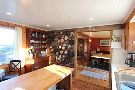 Eastham Cape Cod vacation rental - Full size dining table and sliding doors to deck with gas grill.