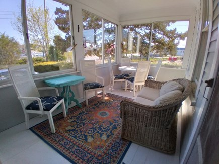 Dennis Cape Cod vacation rental - Screened in porch with game table for rainy days