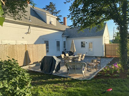 Dennis Cape Cod vacation rental - Backyard view with patio, two outside showers