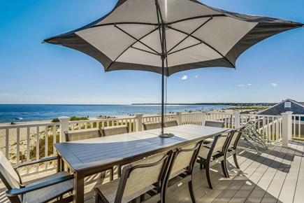 Centerville, Craigville Beach Road Cape Cod vacation rental - Large dining table with large umbrella on the deck.