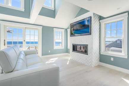 Centerville, Craigville Beach Road Cape Cod vacation rental - Beautiful open fireplace room with 65 in smart tv.