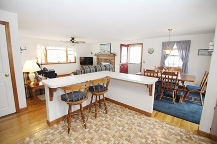Eastham Cape Cod vacation rental - Kitchen looking out to living room and dining area