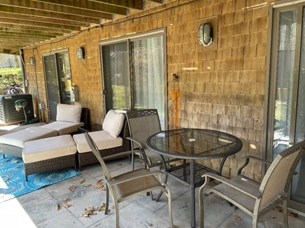 Eastham Cape Cod vacation rental - Private outdoor patio with eating area and chaise lounges