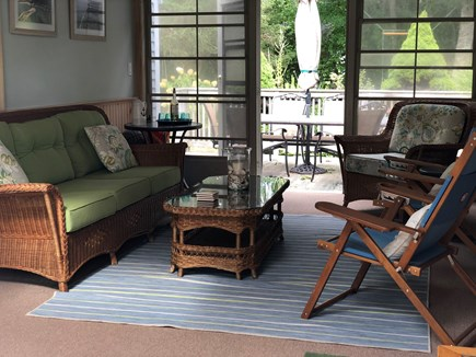 East Falmouth Cape Cod vacation rental - Relax on screened in porch off kitchen w/access to deck & yard
