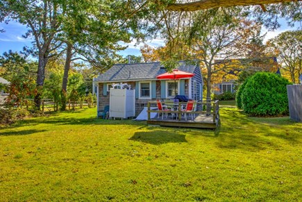East Sandwich Cape Cod vacation rental - Back view of cottage, deck and outdoor shower