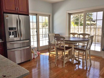 Harwichport Cape Cod vacation rental - Dining seats 6 plus 4 bar stools.  Outdoor table for 10.