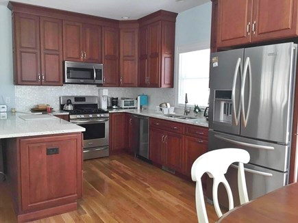 Harwichport Cape Cod vacation rental - Well stocked kitchen with island to seat 4.  Dishwasher!