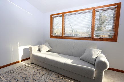 Eastham Cape Cod vacation rental - Sitting room w/pull out sofa, tv & doors that close it off.