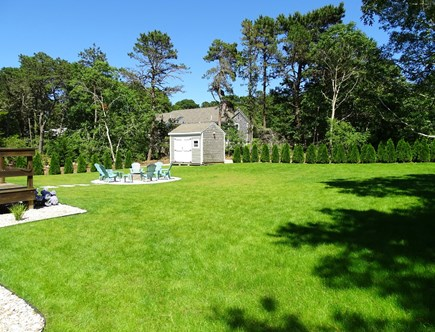 Harwich Cape Cod vacation rental - Private back yard showing new firepit