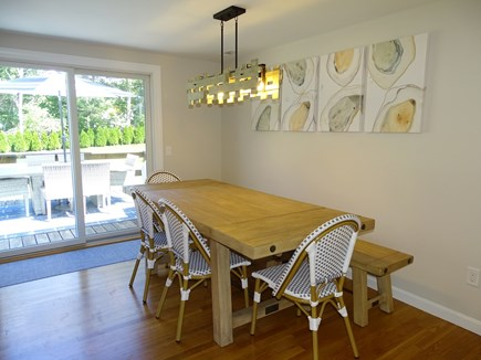 Harwich Cape Cod vacation rental - Dining area seats 8 - opens to backyard