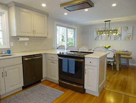 Harwich Cape Cod vacation rental - Renovated Kitchen connected to dining area, slider to deck