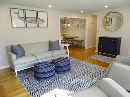 Harwich Cape Cod vacation rental - Living room opens to dining area, slider to deck