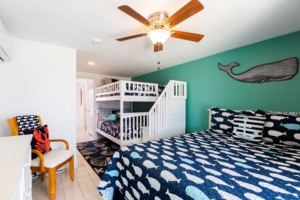 North Truro Cape Cod vacation rental - First floor bedroom has a Queen and two full size bunk beds