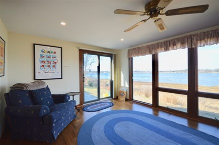 Orleans Cape Cod vacation rental - Sunroom with expansive water views and Olympic art