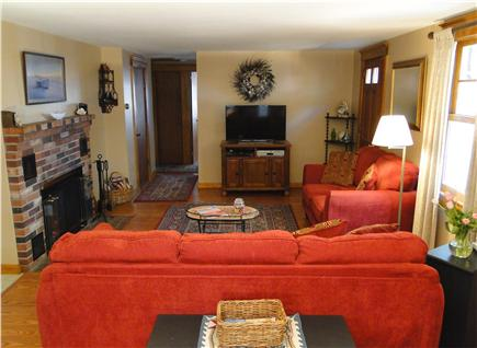 South Wellfleet Cape Cod vacation rental - Living room with fireplace, TV, comfortable seating