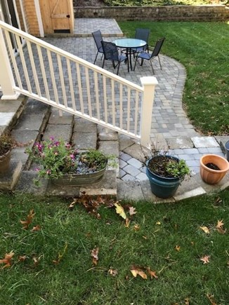 Harwich Cape Cod vacation rental - Patio with dining area and gas grill.