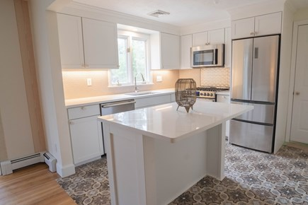 Yarmouth Port Cape Cod vacation rental - Kitchen with stylish island and three stools (not shown in photo)