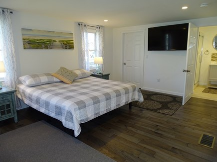 Eastham Cape Cod vacation rental - Master bedroom showing TV and private bath
