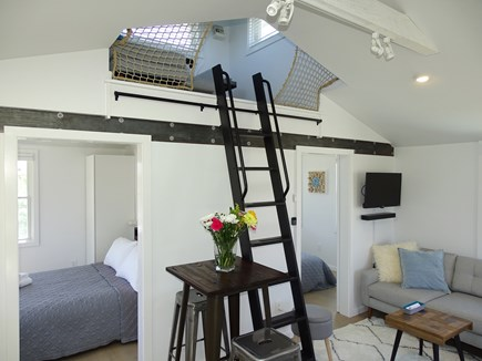Provincetown Cape Cod vacation rental - Living room showing both bedrooms and loft