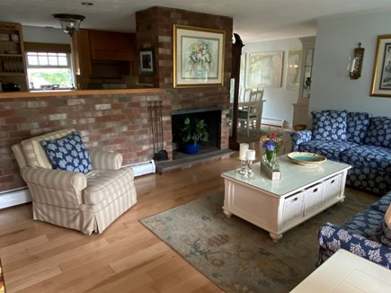 Chatham Cape Cod vacation rental - Cozy living room with fireplace and sectional seating.