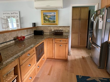 Chatham Cape Cod vacation rental - Kitchen with large pantry and stacked, full-size washer/dryer.
