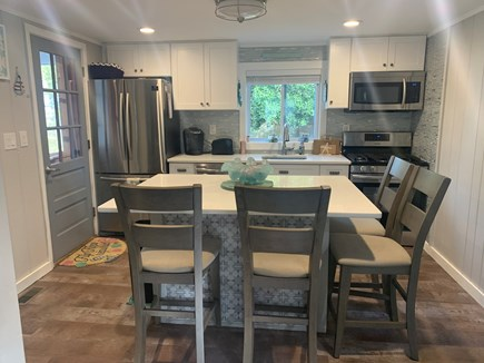 Dennisport Cape Cod vacation rental - Renovated kitchen with island seating for 4.