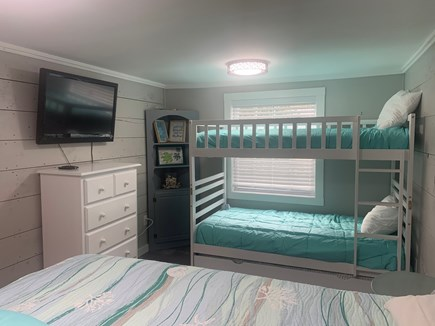 Dennisport Cape Cod vacation rental - Bedroom #1 - twin bunks and trundle, dresser, and tv.