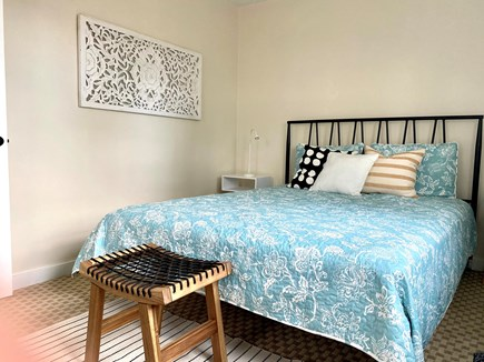 South Yarmouth/Bass River Cape Cod vacation rental - Queen sized bed, reading lamps, and handy stool in the large b/r.