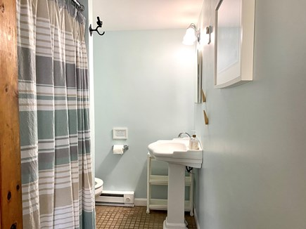 South Yarmouth/Bass River Cape Cod vacation rental - Bathroom with shower, large sink, and storage for toiletries.