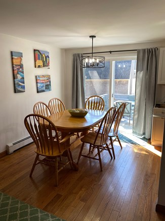 Falmouth Cape Cod vacation rental - Sunlit eat in area with slider leading to deck.