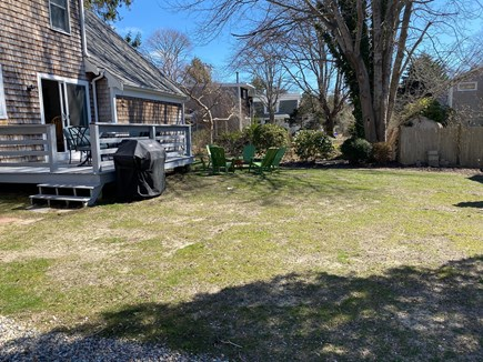 Falmouth Cape Cod vacation rental - Grass will be reseeded, BBQ and firepit.