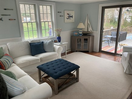 Brewster Cape Cod vacation rental - Sunroom off of the kitchen eating area with doors leading to deck