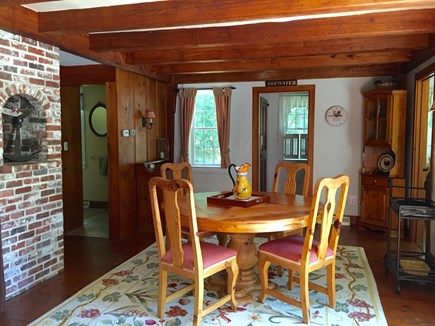 Brewster Cape Cod vacation rental - Kitchen Table with sliding doors out to deck area.