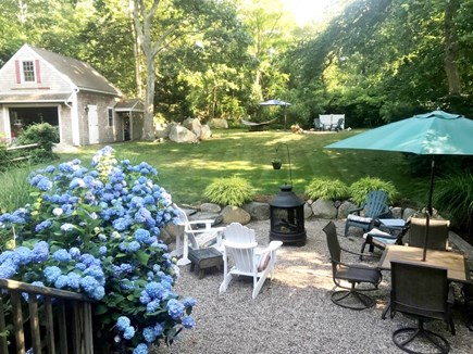 Brewster Cape Cod vacation rental - View from sitting area on top of the porch out into the yard.