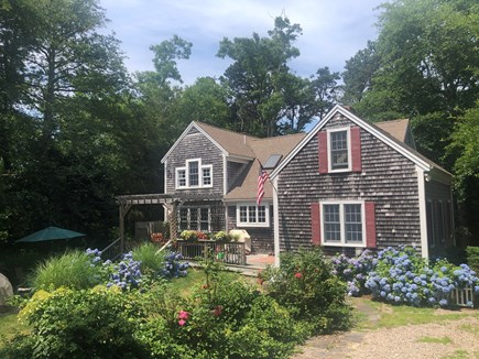 Brewster Cape Cod vacation rental - View from driveway of beautiful flowers and your vacation home.