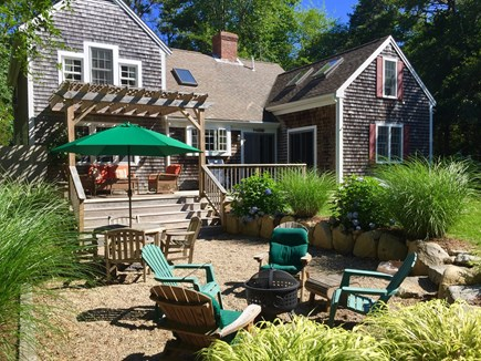 Brewster Cape Cod vacation rental - Outdoor dinning and fire pit area to relax in.