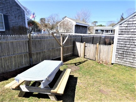 Dennis Port Cape Cod vacation rental - Side yard off the kitchen with a gas grill