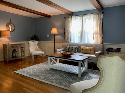 South Dennis Cape Cod vacation rental - Freshly painted living room with new furniture and carpet.