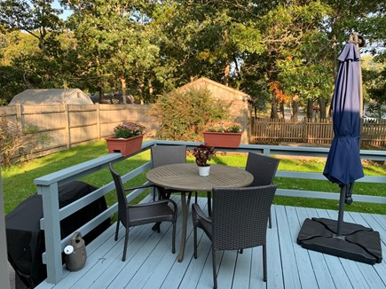 South Dennis Cape Cod vacation rental - Deck overlooking large level yard. New patio/ BBQ and umbrella