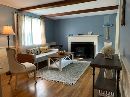 South Dennis Cape Cod vacation rental - Living room with wood fireplace