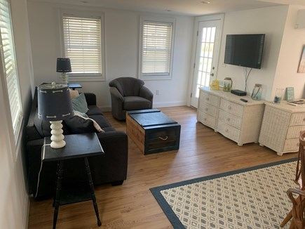Barnstable Cape Cod vacation rental - Den with couch and swivel chair