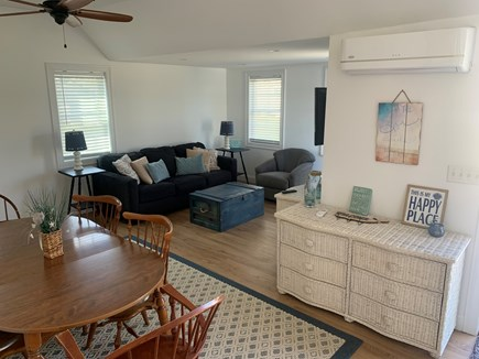 Barnstable Cape Cod vacation rental - Dining area and storage cabinet