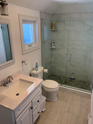 Barnstable Cape Cod vacation rental - Bath with tile floor  and glass door shower